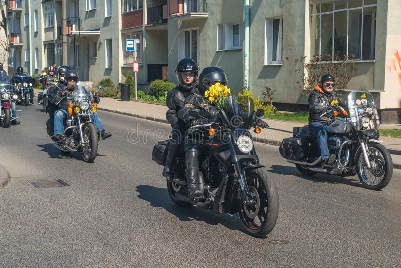 Different motorbikes during oldtimer parade. Different older and newer motorbikes driving on street before start during oldtimer parade for charity for sick royalty free stock photography