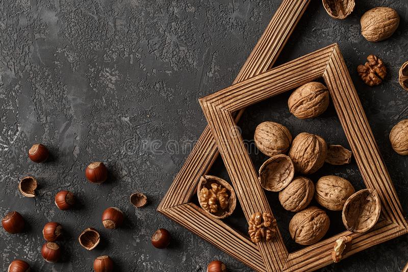 Different nuts on stone table. hazelnut, walnuts. Different nuts on stone table. Cedar, hazelnut, walnuts. Many nuts are inshell and chistchenyh on stone table royalty free stock photography