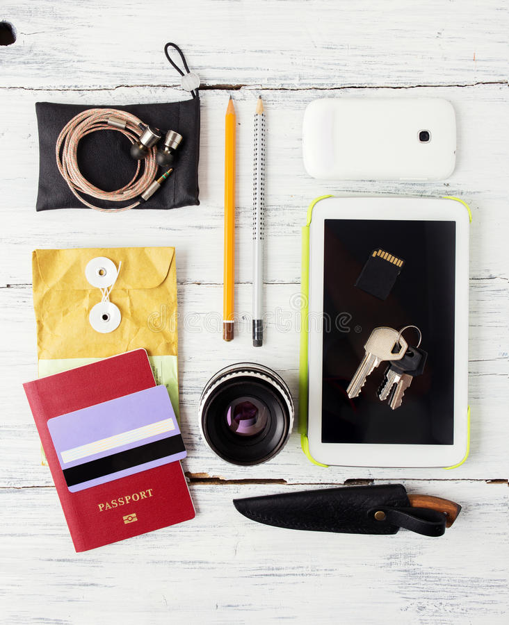 Different objects for traveling on wood. En background stock photos