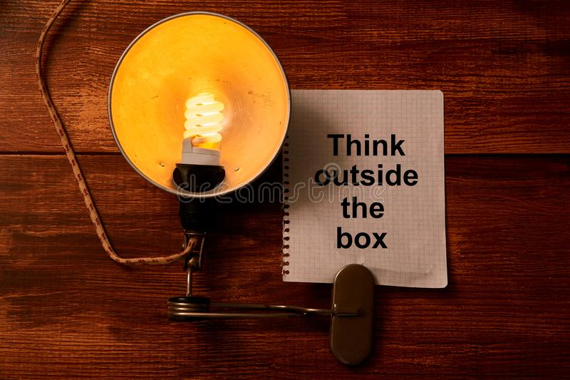 Different and original vision or idea concept.Think outside the box, different way. Vintage lapm and inscription stock image