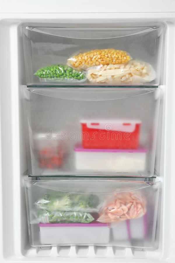 Different packed frozen products in refrigerator stock photos