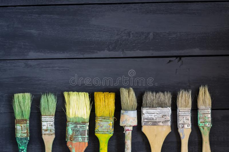 Different paint brushes on a dark wooden table. Copy space. Concept Happy Father`s Day. royalty free stock photos