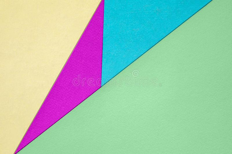 Different pastel colored paper backgrounds with place for text. Abstract different bright colored paper backgrounds with place for text. Diagonal geometric stock photo
