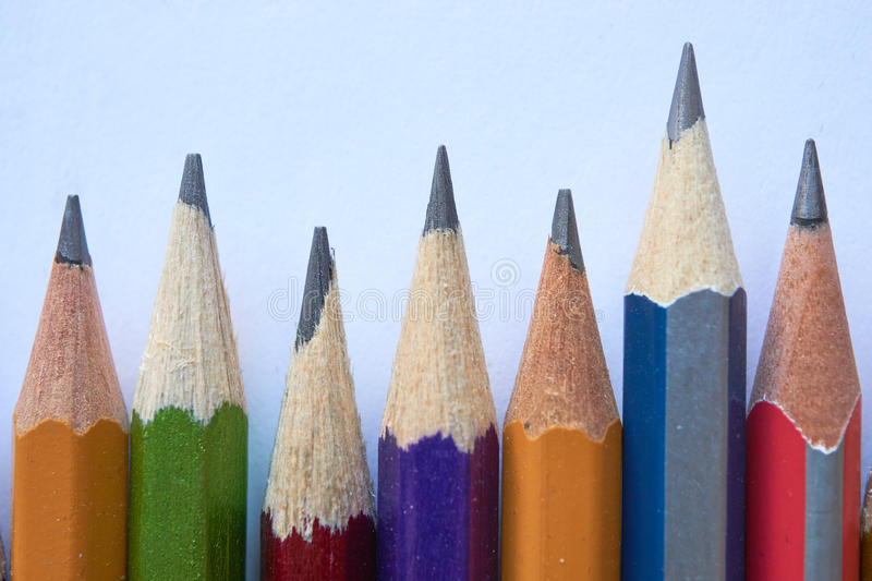 Different pencils in a row royalty free stock photography