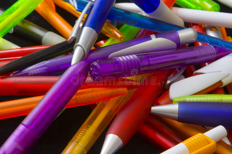 Different pens. On black ground stock images