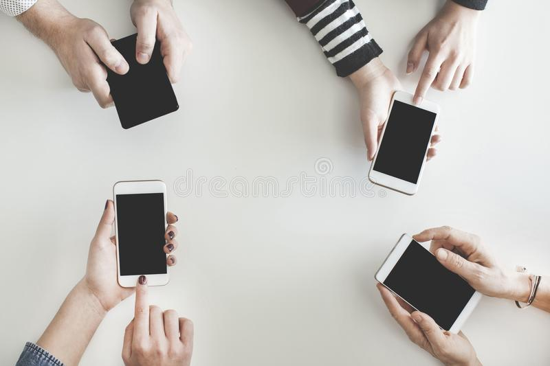 Different people using their mobile phones royalty free stock images