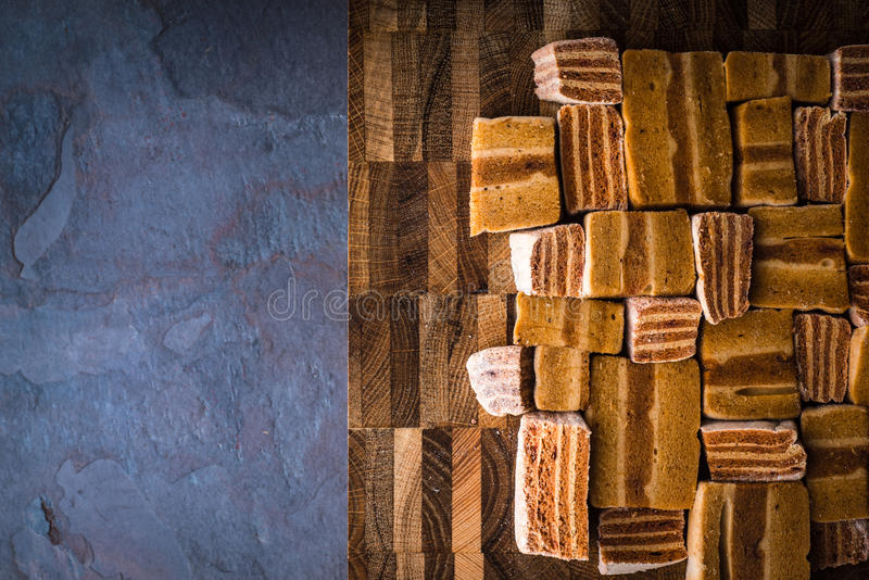 Different pieces of pastila on the wooden board on the stone table. Top view stock photography