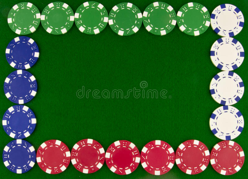 Different poker chips as border. Border of poker chips on green beize royalty free stock images