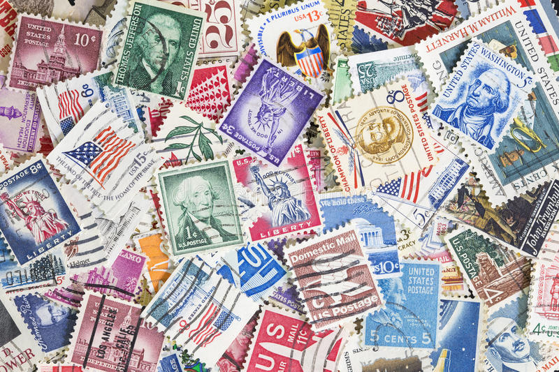 Different postage stamps from United States. Random collection of postage stamps with postmark from United States of America. Can be used as background royalty free stock images