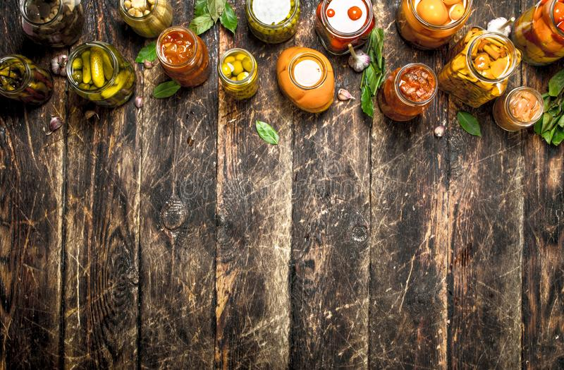 Different preserved vegetables from vegetables and mushrooms in glass jars. royalty free stock photography