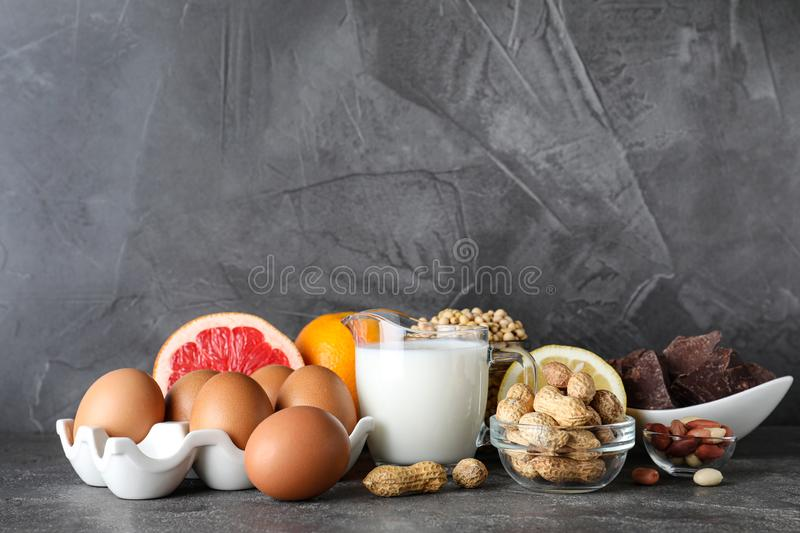 Different products on grey background. Food allergy concept. Different products on grey background, space for text. Food allergy concept royalty free stock photos