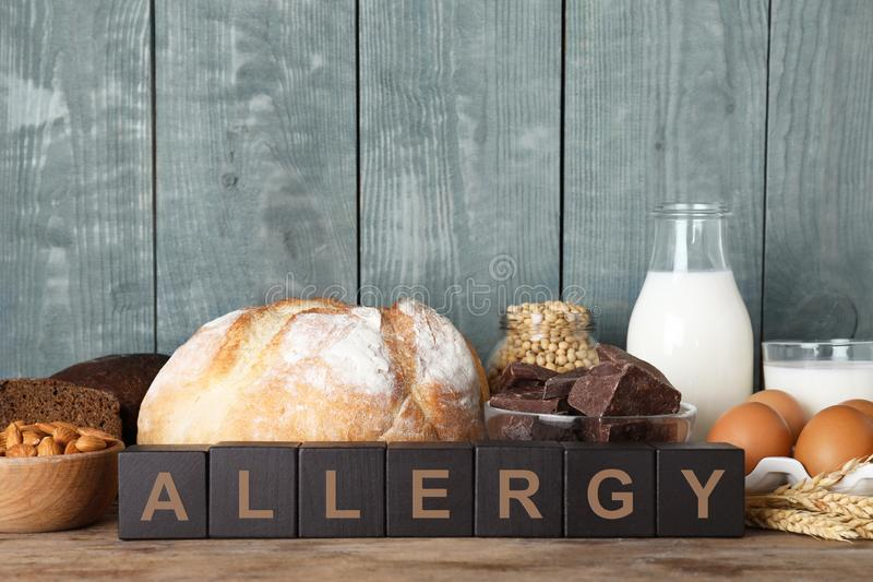 Different products on wooden background. Food allergy. Concept royalty free stock image