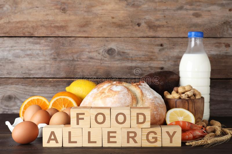 Different products on  background. Food allergy concept. Different products on wooden background. Food allergy concept stock images