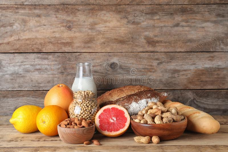 Different products on wooden background. Food allergy concept. Different products on wooden background, space for text. Food allergy concept stock images