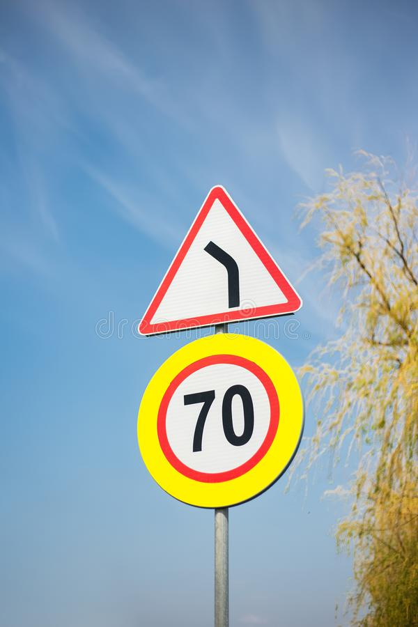 Different road signs on the background of blue sky and a tree royalty free stock image