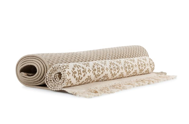 Different rolled carpets on white background royalty free stock photography