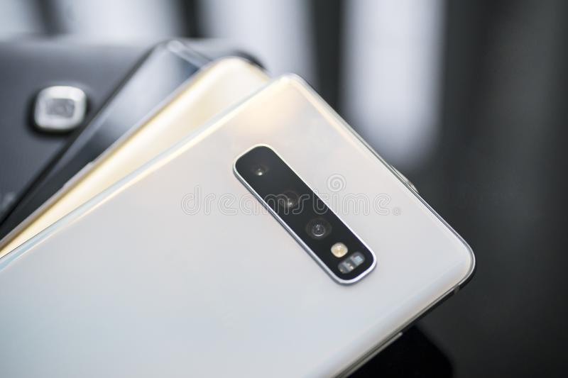Different Samsung smartphone types over the table. JAKARTA - Indonesia. March 21, 2019: Top view of different Samsung Galaxy smartphone types pilling on the royalty free stock images