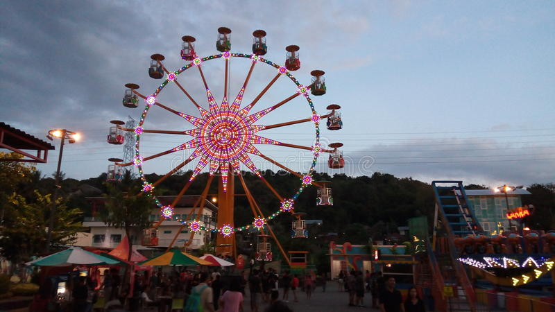 Different scenery with ferris wheel stock images