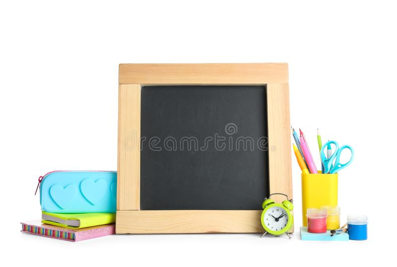 Different school  and small blank chalkboard on white background. Space for text. Different school stationery and small blank chalkboard on white background stock image