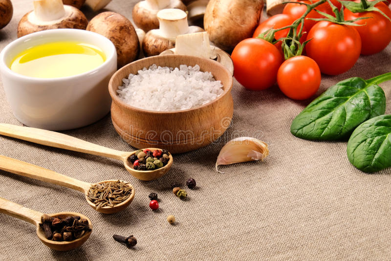 Different seasonings with vegetable and mushrooms. royalty free stock photo