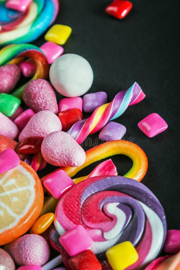 Different sets on a black background, candy, chewing gum, candy. On black background stock photo