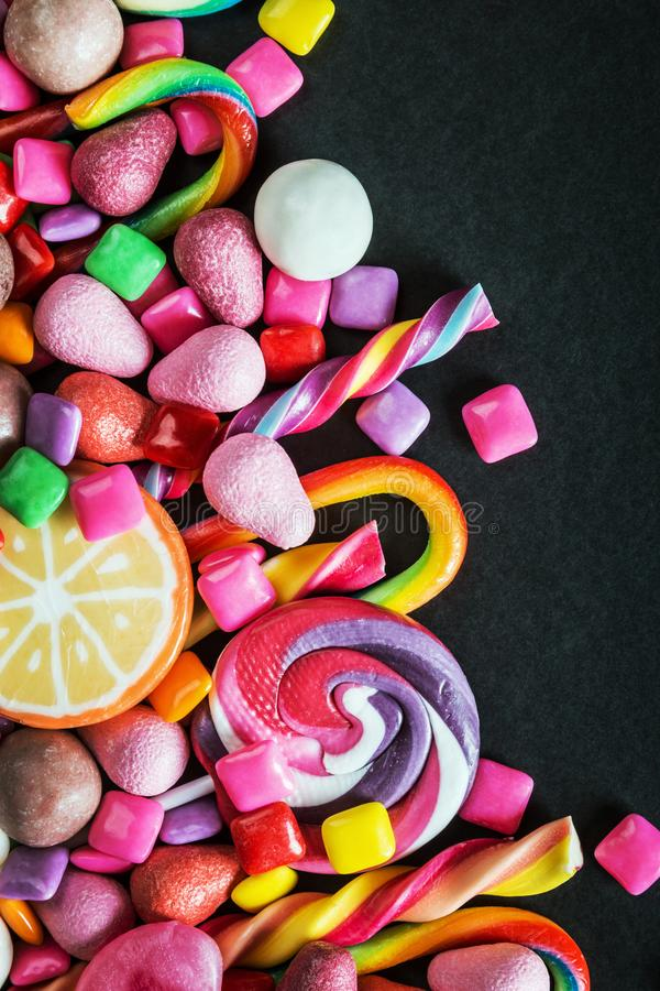 Different sets on a black background, candy, chewing gum, candy. On black background stock photography