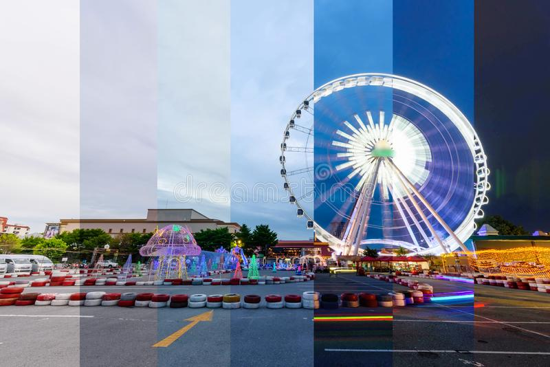Different shade color Ferris wheel in amusement park with Small quad bike for child park stock images