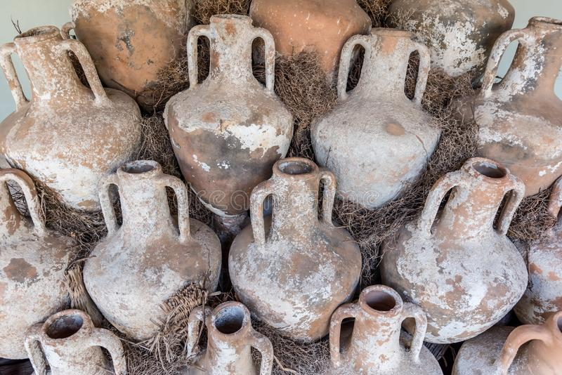 Different shape and size of amphoras royalty free stock photo