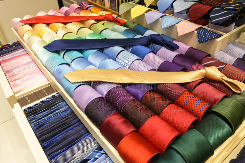 Different silk neckties on shelves royalty free stock images