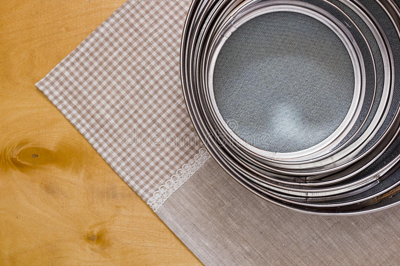 Different sized sieves. Set of kitchen tools for sifting flour. The set consists of different sized sieves stock photo