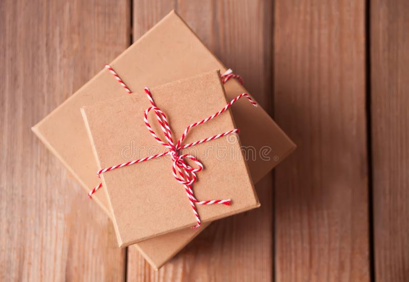 Different sizes Christmas gift boxes on the wooden background.  stock images