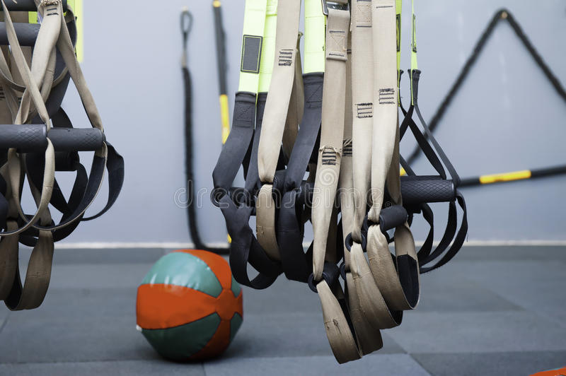 Different sizes of kettlebells weights lying on gym floor. Equipment commonly used for crossfit training at fitness club stock image