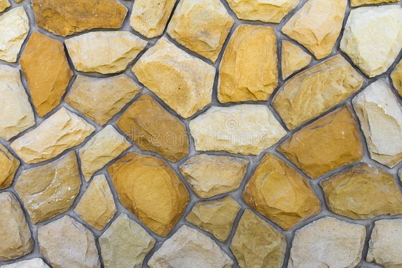 Different sizes of sand stones. Stone wall pattern background royalty free stock images