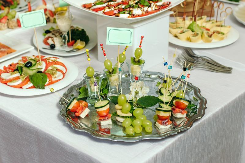 Different sort of fruit canape for a self service buffet. stock images