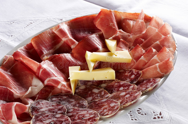 Different sort of salami and prosciutto stock photo
