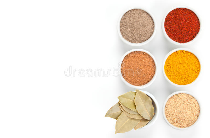 Different spices in bowls on white. stock photography
