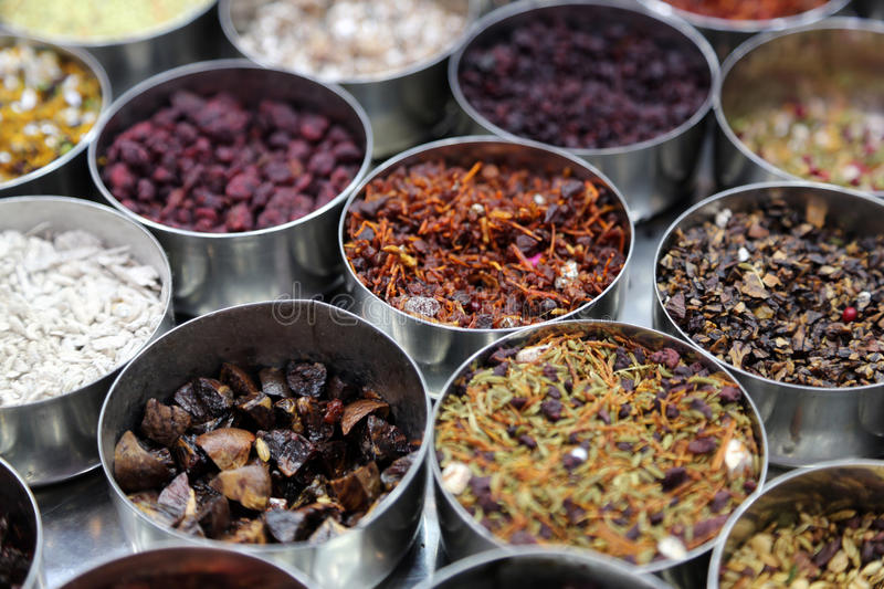 Different spices and herbs in metal bowls on a street market in Kolkata stock photos