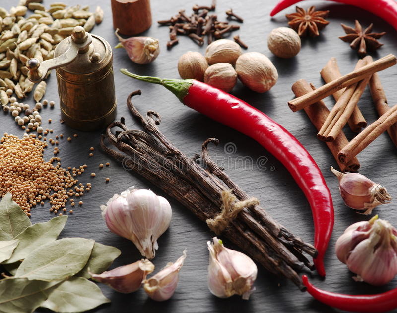 Different spices on rocked table. Food background stock photo