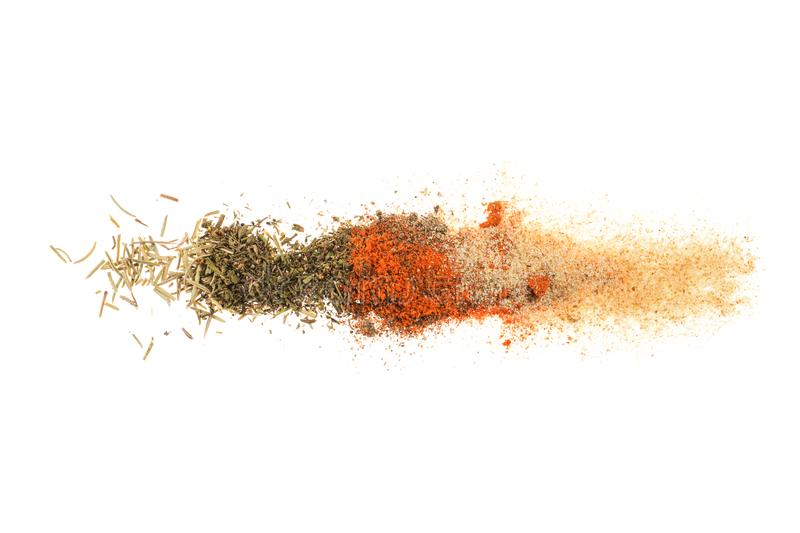 Different spices row on white stock images