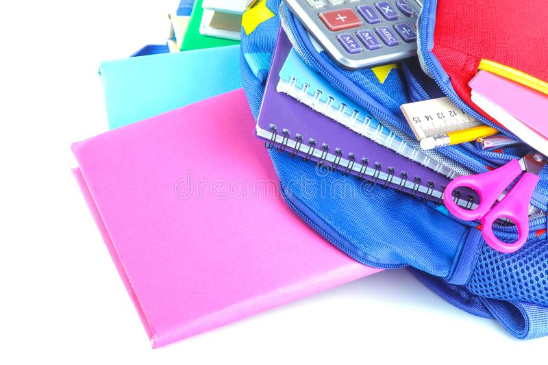 Different stationery and school supplies lying in a school backpack on a white isolated background royalty free stock photos