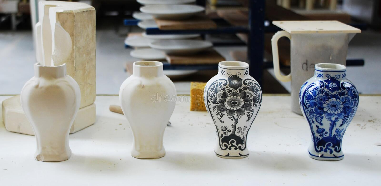 Different steps for creating traditional Delft ceramic blue vase. Different steps for creating traditional Delft ceramic vase royalty free stock images