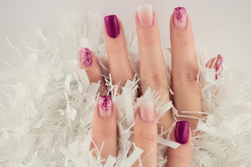 Nails in purple tones isolated on white background. Different styles of decoration for nails - shine, mixing colors, uniform colors.Sexy fashion for ladies` stock photography
