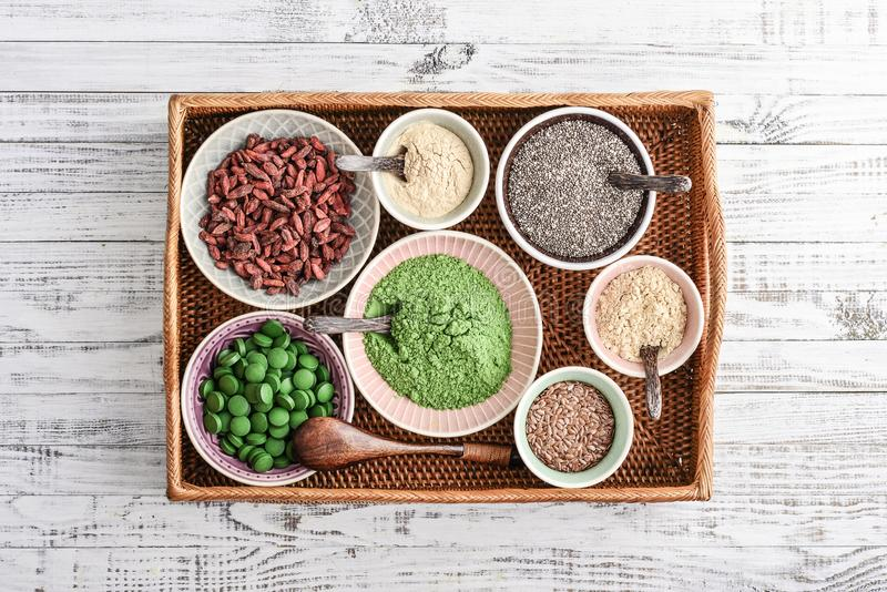 Different super foods in bowls. On a rattan tray, top view royalty free stock photo