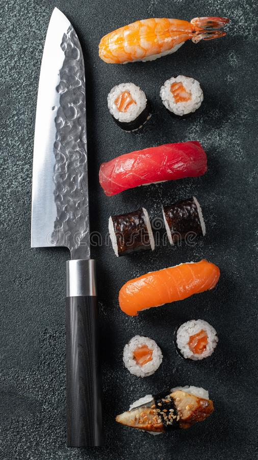 Different Sushi with Japanese knife. flat lay. royalty free stock photo