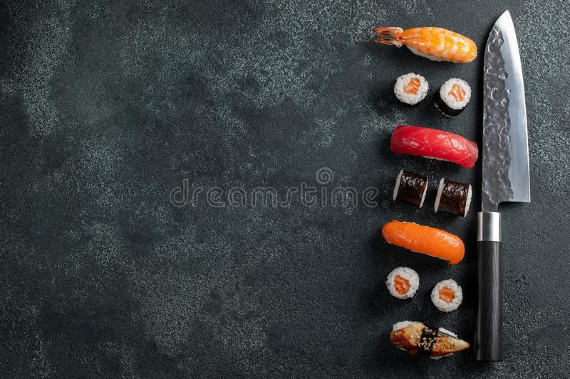 Different Sushi with Japanese knife on concrete stock photos