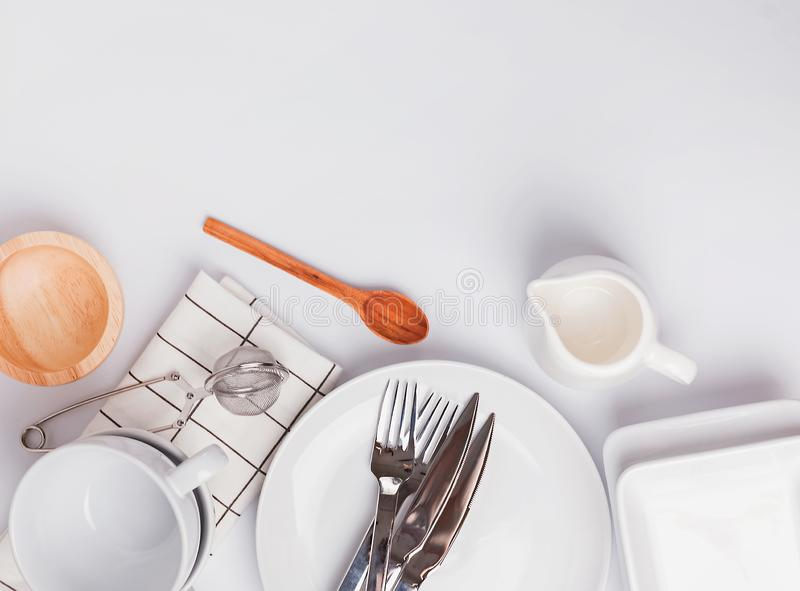 Different tableware and dishes on the white background, top view. stock photography