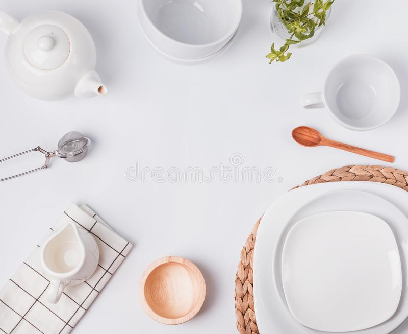 Different tableware and dishes on the white background, top view. royalty free stock images