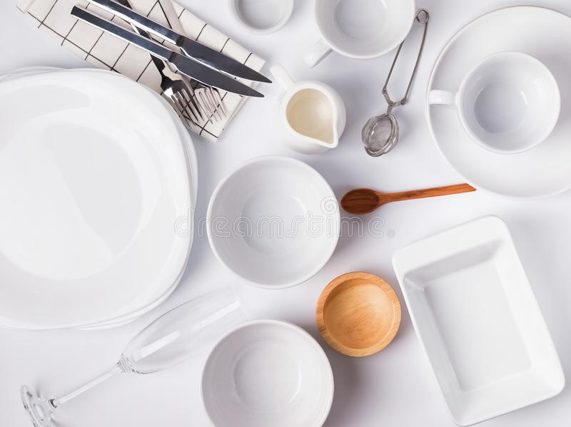 Different tableware and dishes on the white background, top view. stock photos