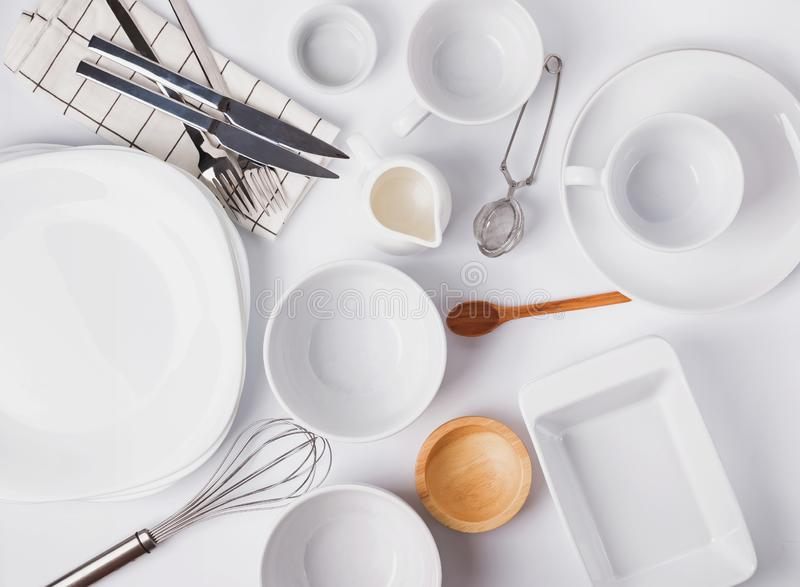 Different tableware and dishes on the white background, top view. royalty free stock photography