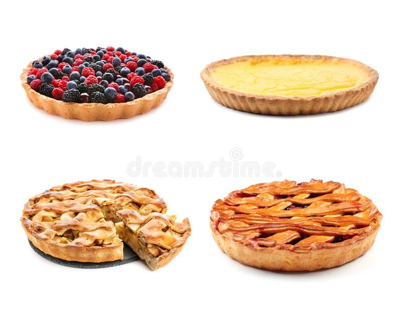 Different tasty fruit pies on white background stock photography